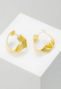 P D Paola - GRAVITY - Örhänge - gold-coloured - 0