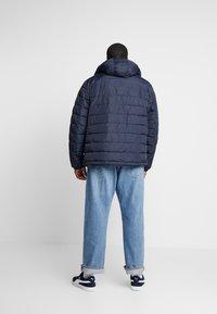 Tommy Hilfiger - QUILTED HOODED JACKET - Light jacket - blue - 2