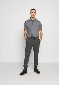 Calvin Klein - LIQUID HEATHER - Polo shirt - black - 1