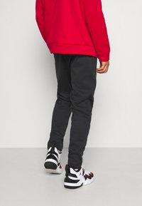 Jordan - AIR THERMA PANT - Teplákové kalhoty - black/white - 2