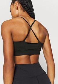 South Beach - STRAPPY TWIST BRALET - Sujetadores deportivos con sujeción ligera - black - 5