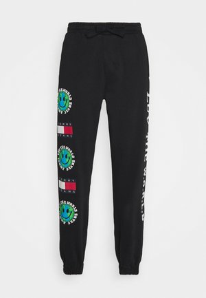 LUV THE WORLD - Tracksuit bottoms - black