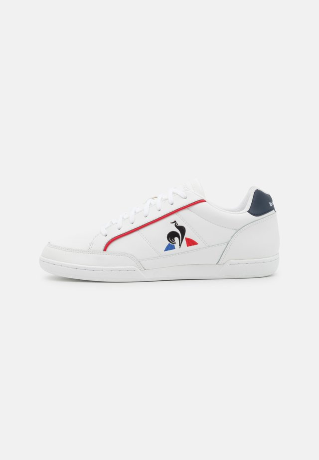 TOURNAMENT UNISEX - Sneakers - optical white/dress blue