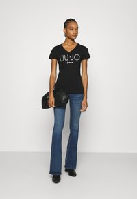 Liu Jo Jeans - BEAT REG - Vaqueros bootcut - blue avatar wash - 1