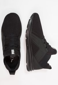 Puma - ENZO WEAVE - Sports shoes - black/white