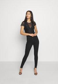 Morgan - DONAO - Camiseta estampada - noir - 1