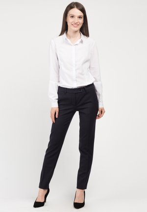 BUFFY - Trousers - black
