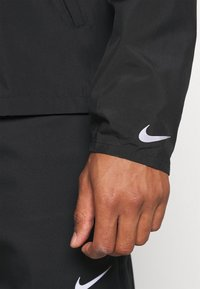 Nike Performance - NIKE RUN DIVISION FLASH - Sports jacket - black/silver - 3