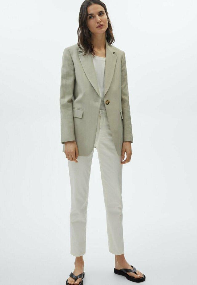 SLIM FIT - Pantaloni - white