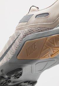 Nike Performance - LEGEND ESSENTIAL - Sports shoes - string/dark smoke grey/smoke grey/light brown - 5