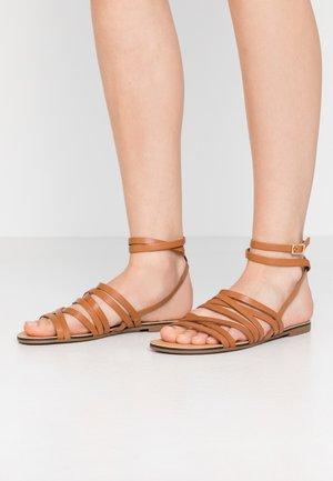 TIA - Sandals - saddle