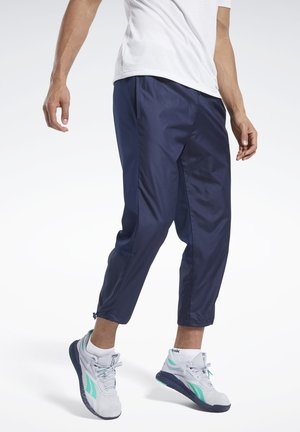 WOVEN JOGGERS - Tracksuit bottoms - blue