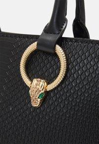 ALDO - NYDIVIEL - Handbag - black/light gold-coloured - 3