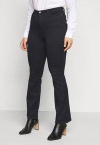 Vero Moda Curve - VMMARIA  - Flared jeans - black - 0