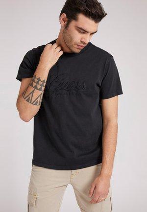 T-shirt con stampa - schwarz
