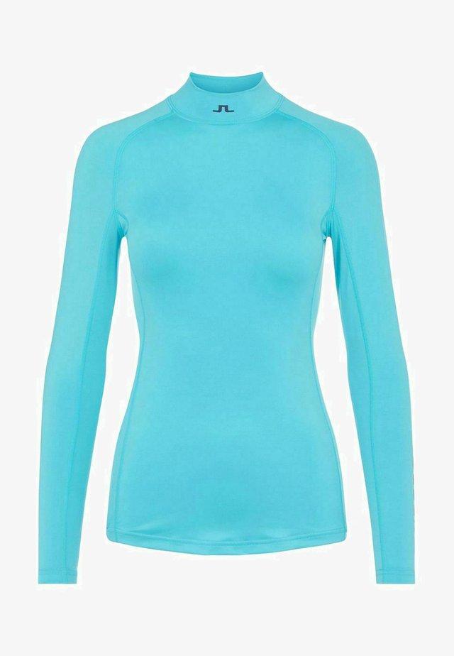 OBERTEIL ÅSA COMPRESSION - Sports shirt - beach blue