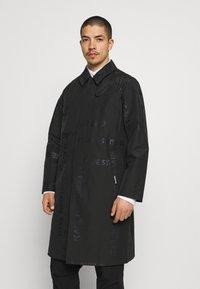 KARL LAGERFELD - UNISEX - Waterproof jacket - black - 0
