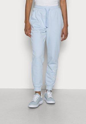 HERITAGE - Pantaloni sportivi - breezy blue