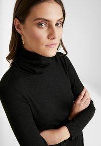 Great Plains London - TAMARA TIE - Jumper dress - black/gold - 4