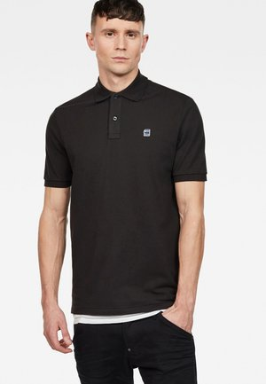 DUNDA - Polo shirt - black