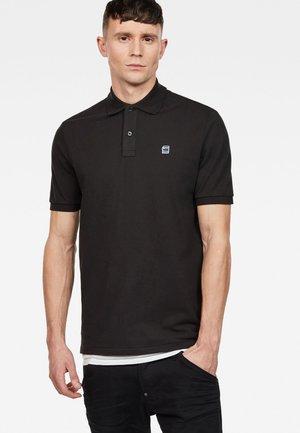 DUNDA - Poloshirt - black