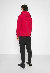 Calvin Klein Jeans - SUSTAINABLE MILANO PANT - Verryttelyhousut - black - 2