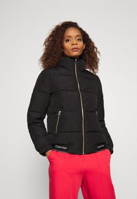 Calvin Klein - LOGO PUFFER JACKET - Winter jacket - black - 0