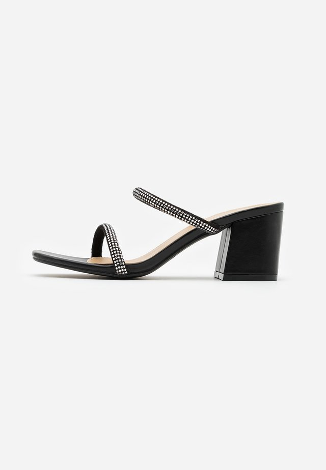 CARLY - Heeled mules - black