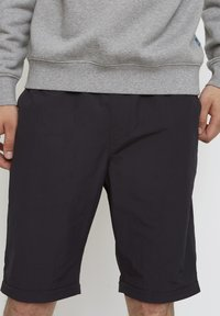 Timberland - WOODWOOD 2IN1 HIKE PANT - Tracksuit bottoms - obsidian - 4