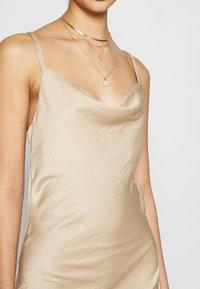 Vero Moda - VMCENTURY OPEN BACK DRESS - Ballkjole - gilded beige - 5