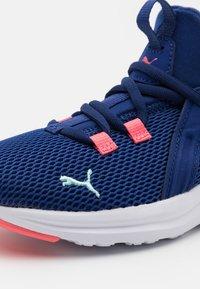 Puma - ENZO 2 WEAVE AC UNISEX - Neutral running shoes - elektro blue/island paradise - 5