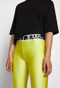 Versace Jeans Couture - Leggings - Trousers - verde mela - 3