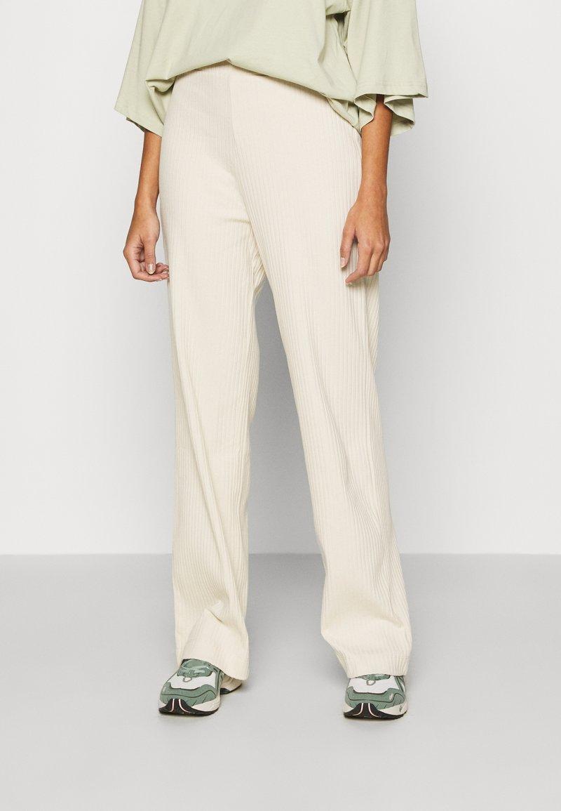 Monki - CLARA TOUSERS - Trousers - beige