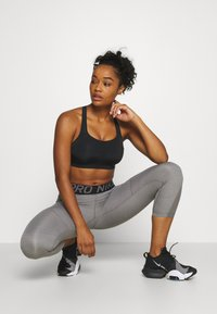 Nike Performance - ALPHA BRA - High support sports bra - black/white - 1