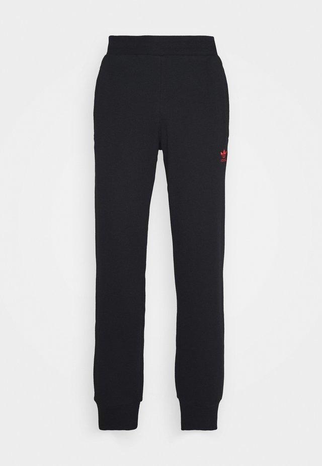 TREFOIL PANT UNISEX - Pantaloni sportivi - black/scarle