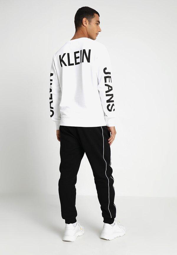 Calvin Klein LOGO PRINT - Spodnie treningowe - perfect black/czarny Odzież Męska BTRE