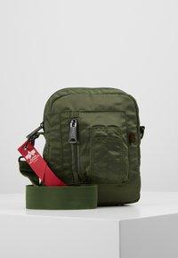 Alpha Industries - CREW CARRY BAG - Across body bag - sage green - 0