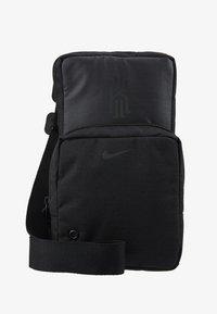 Nike Performance - KYRIE IRVING FESTIVAL BAG - Across body bag - black/dark smoke grey - 5