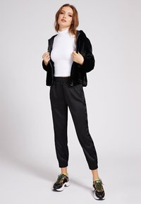 Guess - Winter jacket - schwarz - 1