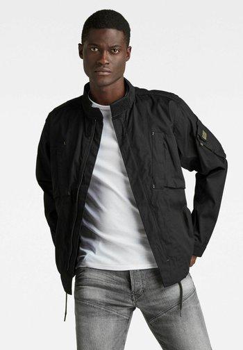 SPORTY SLANTED POCKET INDOOR - Summer jacket - dk black