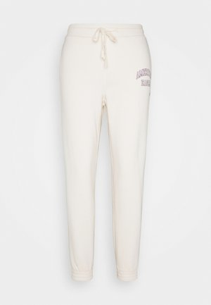 INTERNATIONAL BRANDED JOGGER - Pantalones deportivos - toasted coconut