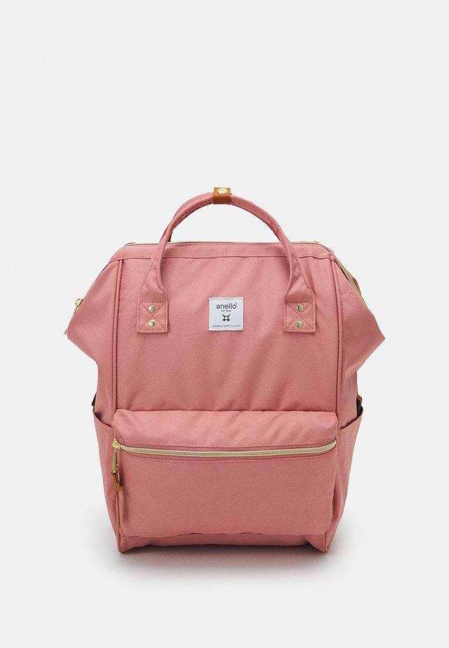REPREVE CROSS BOTTLE UNISEX - Batoh - pink