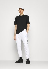 Nike Sportswear - PANT - Tracksuit bottoms - white - 1