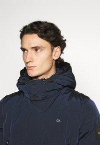 Calvin Klein - CRINKLE LONG LENGTH JACKET - Winter coat - blue - 4