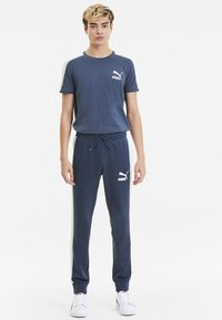 Puma - PUMA ICONIC T7 KNITTED MEN'S TRACK PANTS MALE - Tracksuit bottoms - dark denim - 1