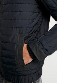 Calvin Klein Jeans - PADDED HOOD ZIP THROUGH - Light jacket - black - 4