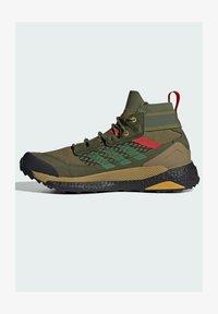 adidas Performance - FREE HIKER BOOST PRIMEKNIT HIKING SHOES - Hikingskor - green - 0