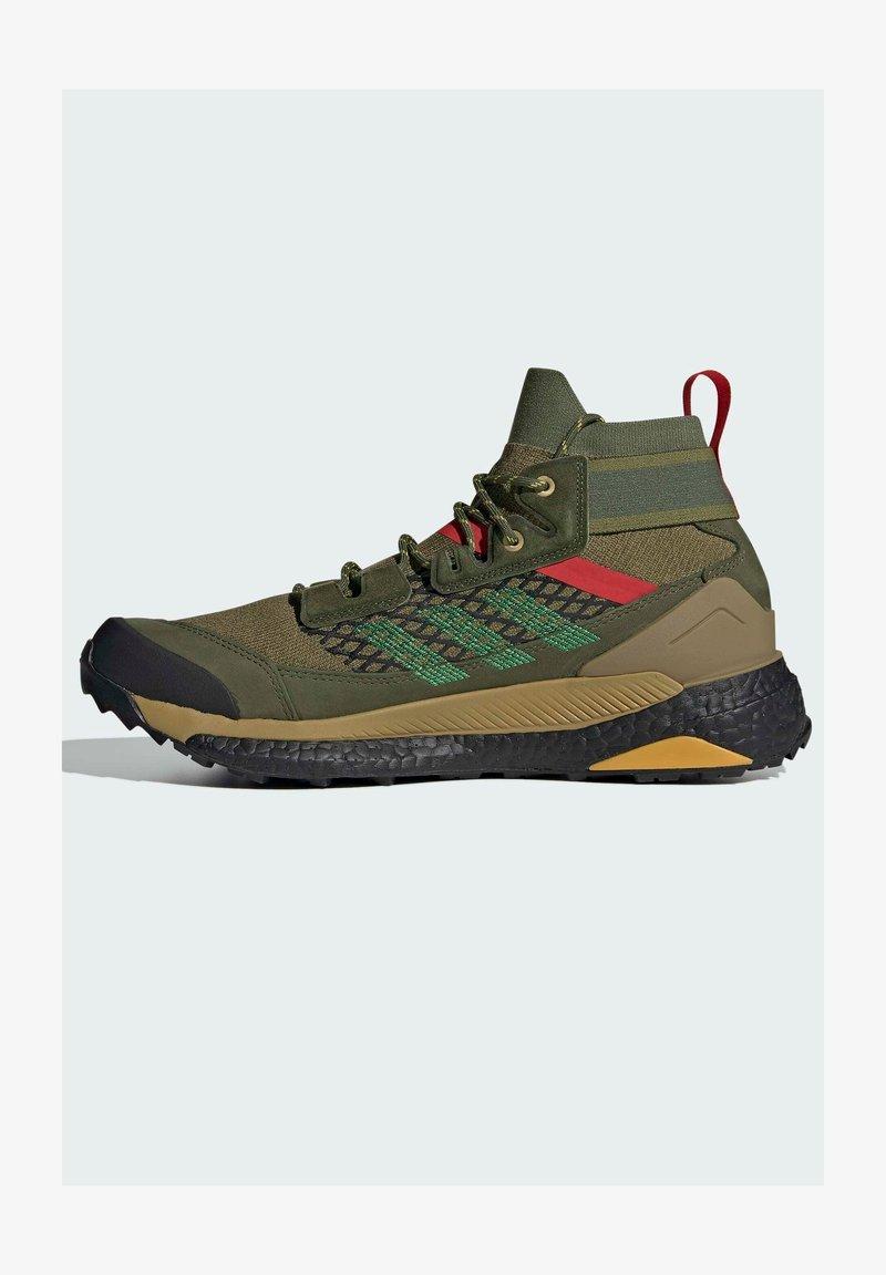 adidas Performance - FREE HIKER BOOST PRIMEKNIT HIKING SHOES - Hikingskor - green