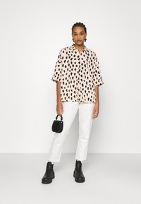 Monki - TAMRA BLOUSE - Button-down blouse - beige - 1