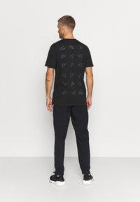 adidas Performance - Pantalon de survêtement - black - 2
